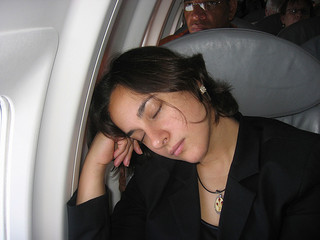 Sleeping-on-plane-small__152628412