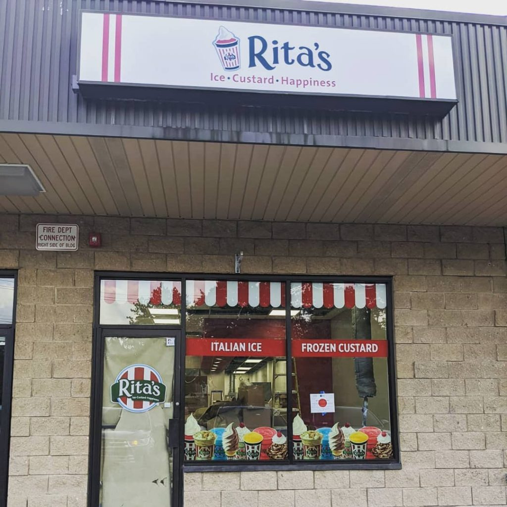A storefront with a sign for Rita's