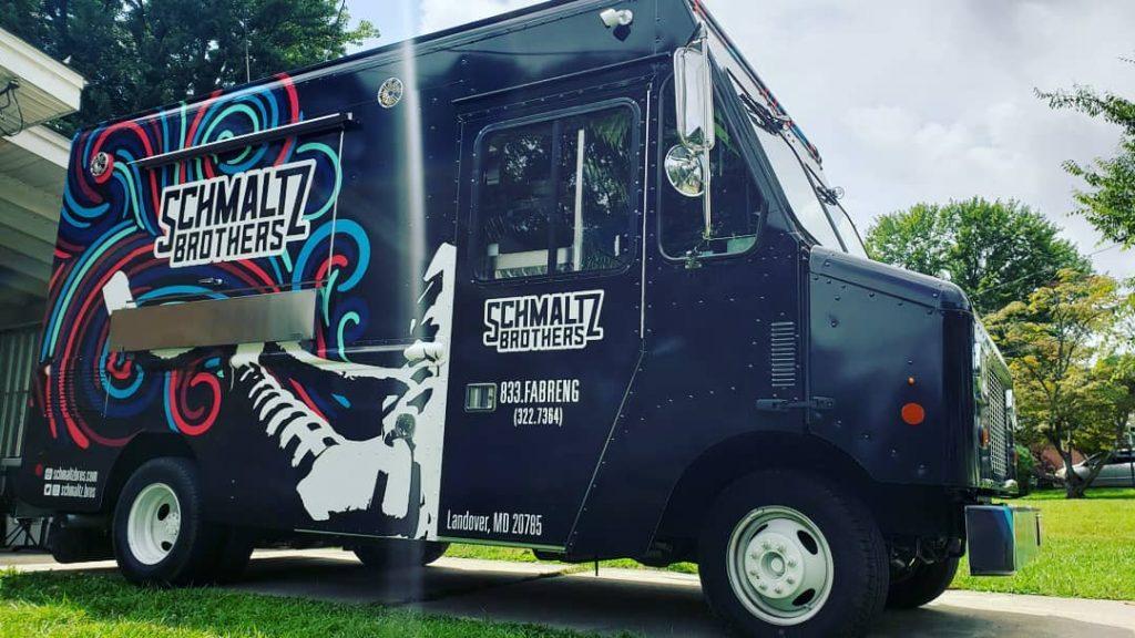 food truck on a grassy lawn