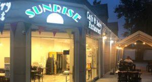 sunrise cafe corner door