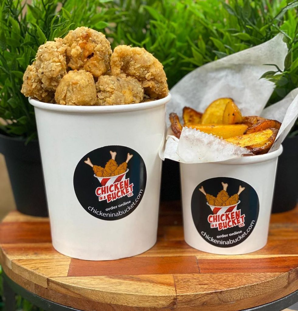 fried chicken in a bucket. thick fries in a bucket