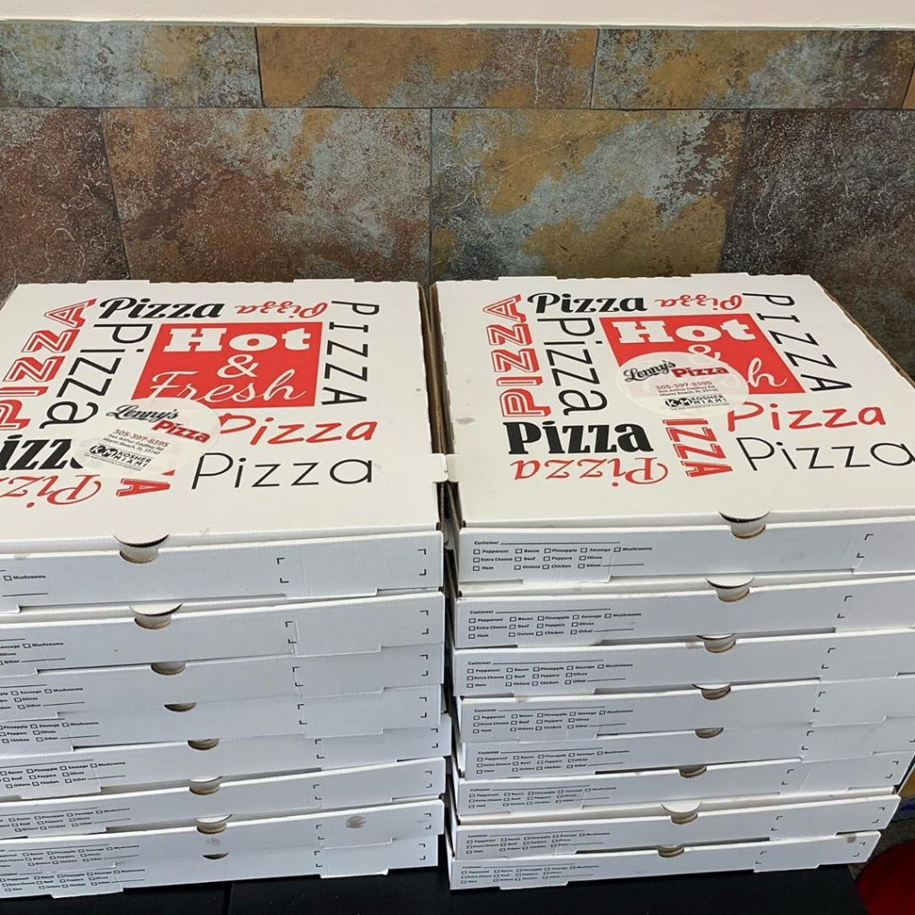 two stacks of pizza boxes