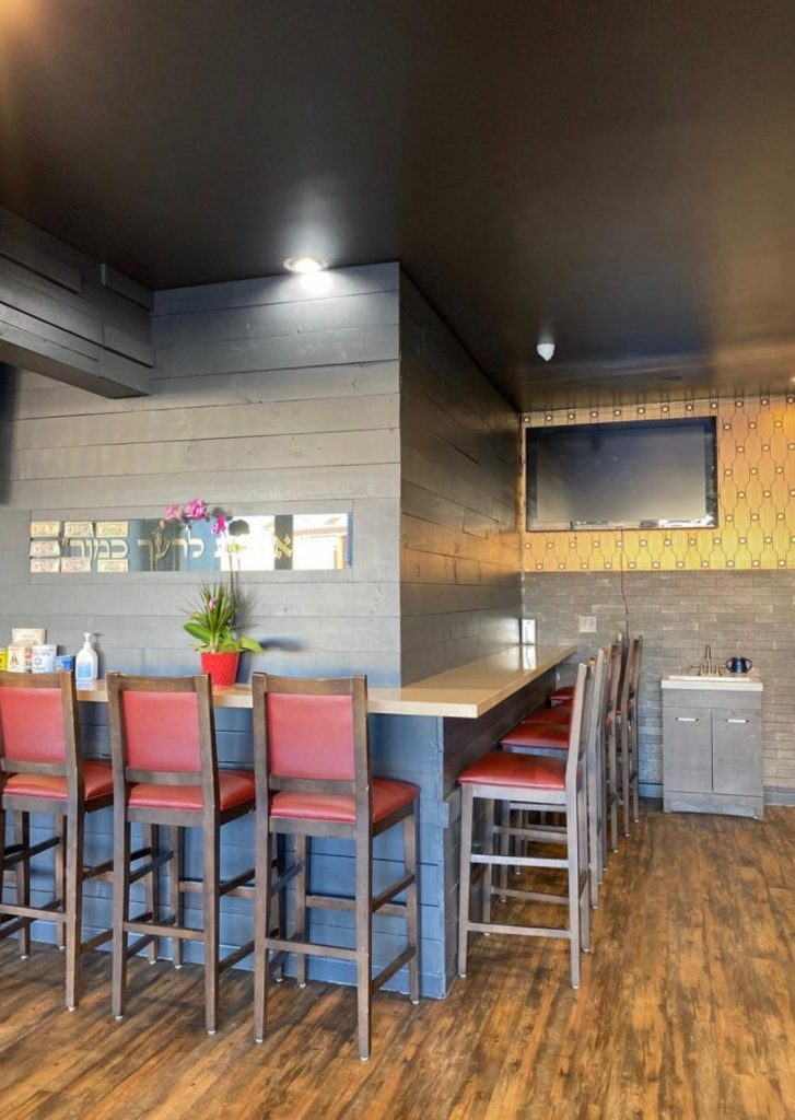 bar style seating with grey walls