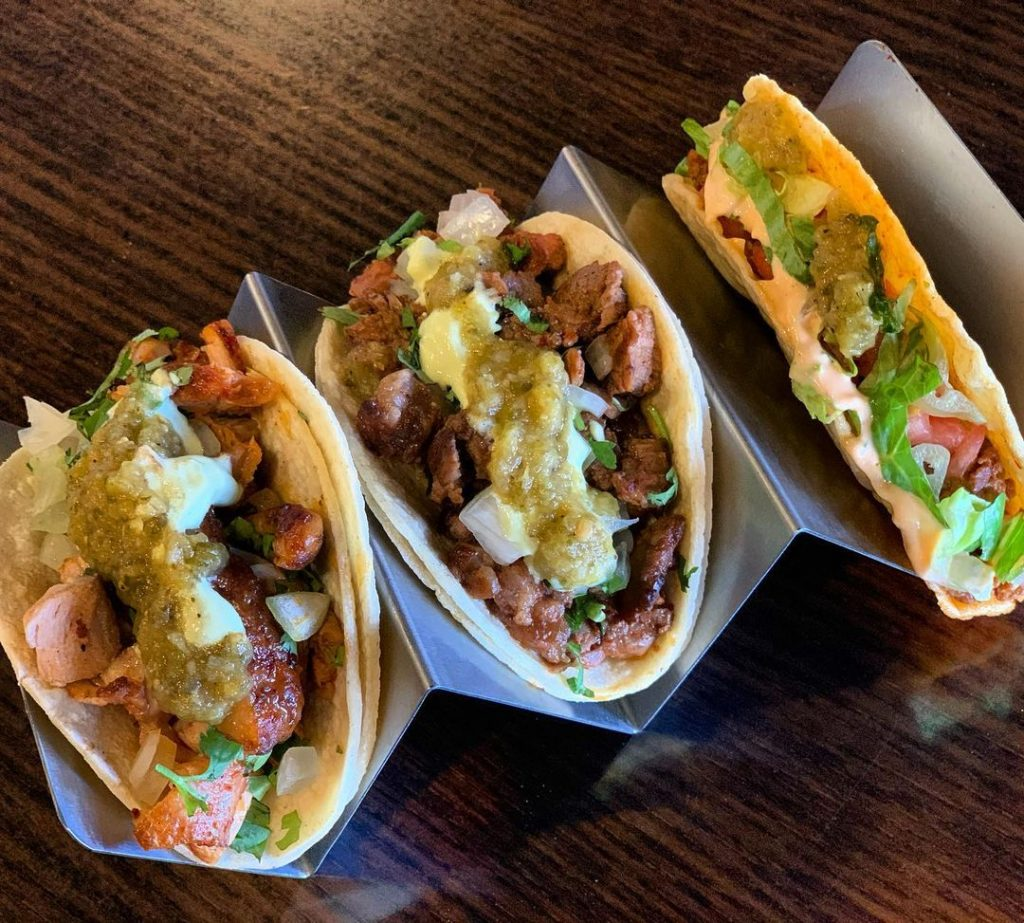 three tacos in a taco holder
