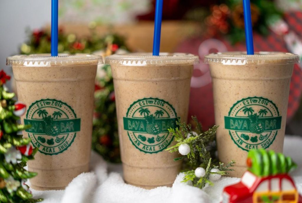 three chocolate smoothies lined up in a row