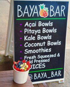 a sign for Baya Bar advertising their menu