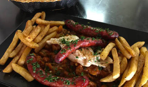 a plate with sausage and fries