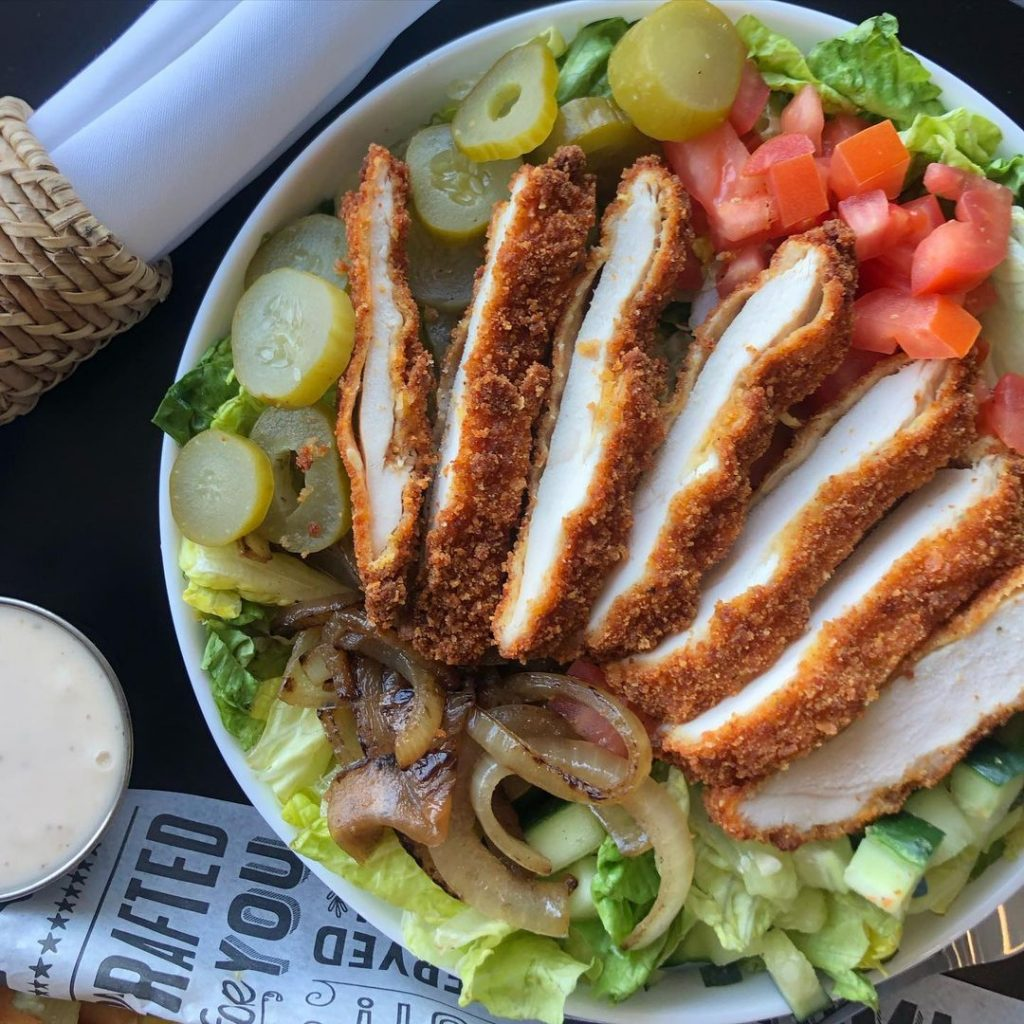 an aerial view of a schnitzel salad